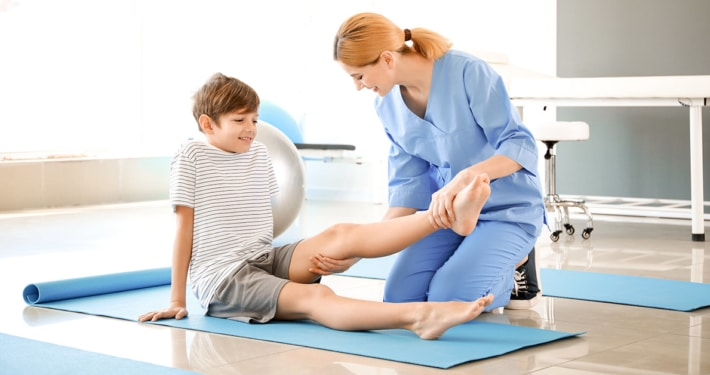 young child receiving physical therapy